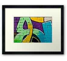 Abstract graffiti detail on the brick wall Framed Print