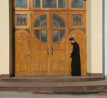 Priest Locking Church Doors, Chortkiw Ukraine by Yuri Lev