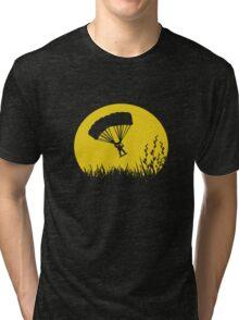 Parachuting down to earth.. Tri-blend T-Shirt
