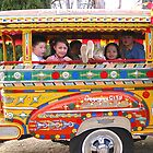 Filipino kids relax onboard a Philippines jeepney by Dave P
