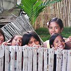 Philippines girls peering over the fence by Dave P
