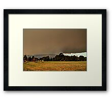 Smoke over the hills Framed Print