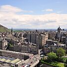 View over Edinburgh, with Arthurs seat in the back round. by Finbarr Reilly