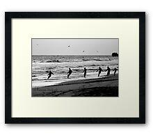 Fishermen net fishing  on the beach Framed Print