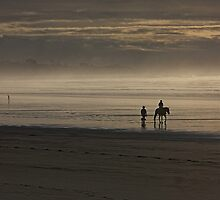 Horse rider on misty beach by Duncan Cunningham