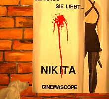 Hans Checks Out Nikita, Greta Does Not by Jim Lively