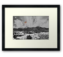 MOUNTAINS, SKY AND A YELLOW PLANE Framed Print