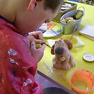 patiently painting pottery - Joss by armadillozenith