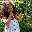 eating grapes by Angel Warda