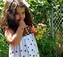 eating grapes by Angel Warda
