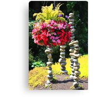 Flower Basket and Rock Statues Canvas Print