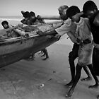 Fishermen bring the boat in,Puri,India 2005. by Neil Bussey