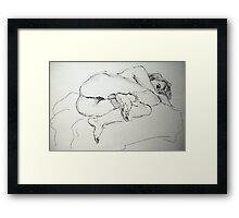 Faith curled up on her side Framed Print