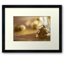charm and beauty through some gold rings Framed Print