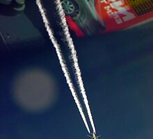 Contrails at 35,000 feet over car magazine..... by BaZZuKa