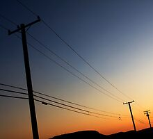 sunset phone poles by Varujhan  Chapanian