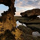 Porthole on Erosion Coast by Robert Mullner