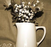 lily of the valley in vase by Lynne Prestebak