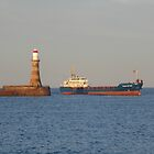 Boat passing the lighthouse by Tony Blakie
