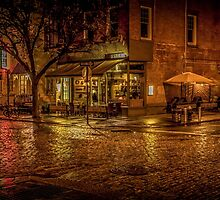 Rain On The Cobblestones Of Greenwich Village by Chris Lord