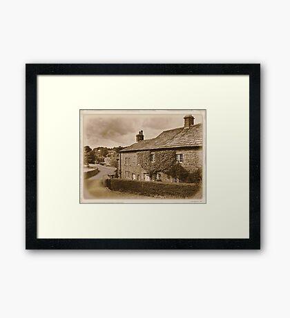 Downham a village unchanged Framed Print