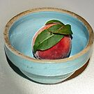 peach in blue bowl by Lynne Prestebak