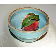 peach in blue bowl Photographic Print