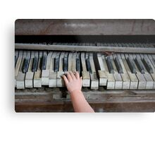 Creepy Piano Baby Metal Print