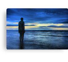 Statues on the beach Canvas Print