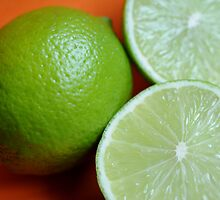 limes on orange by peninsulaphoto