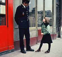 Paris, France policeman and young girl. by Brian McInerney