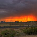 Rainband sunset by NikonLarry
