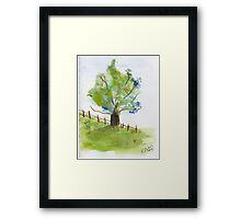 Tree in a green field with blue flowers - watercolor painting la Framed Print