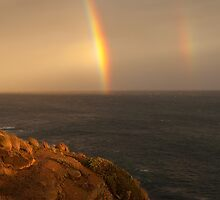 cliff rainbows by Tony Middleton