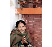 Keeping warm in prayer Photographic Print