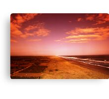 sunset over the beach Canvas Print