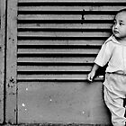a boy leaning against the door by irenaeus herwindo