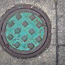Mini Manhole for a Mini Man by Tama Blough