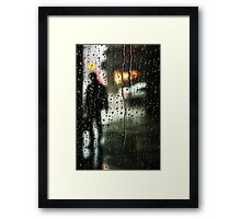 Waiting out the rain Framed Print