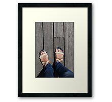 female legs in sandals Framed Print