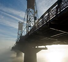 Hawthorne Bridge in Portland with fog and sun. by Andrew Ferguson