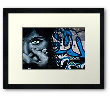 Graffiti face on the textured brick wall Framed Print