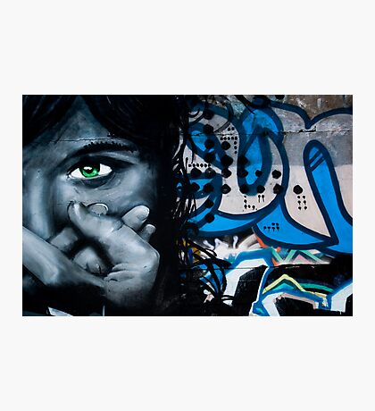 Graffiti face on the textured brick wall Photographic Print