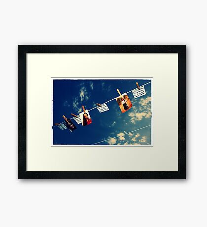 I had to hang up our memories for they got a little wet in the fire Framed Print