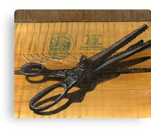 vintage pinking shears sitting on a taped box Canvas Print