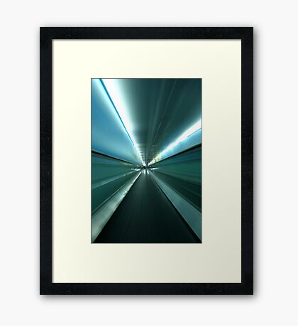 By The Light of The Tunnel Framed Print