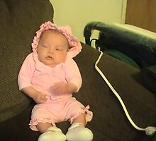 my neice siting in the little corner of the couch at five weeks by christelljune