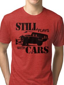 Still plays with cars  Tri-blend T-Shirt