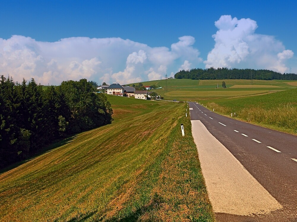 Country road and cloudy blue sky | landscape photography by Patrick Jobst