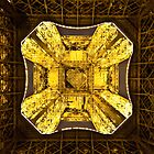 The Eiffel tower at night looking up by John Miner